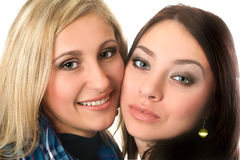 Closeup portrait of beautiful smiling young women Stock Image