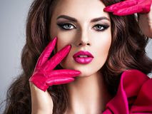 Closeup portrait of a beautiful stylish girl wearing pink gloves stock images