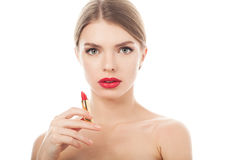 Closeup portrait of a beautiful woman with beauty face and clean skin. With lipstick in hand Royalty Free Stock Photos