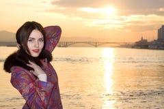 Closeup portrait of beautiful woman near the river Stock Photos