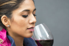 Closeup portrait of beautiful woman with red wine glass. Stock Images