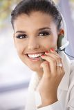 Closeup portrait of beautiful young dispatcher. Smiling, looking at camera Stock Photography