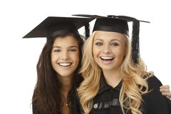 Beautiful graduates smiling happy Royalty Free Stock Images
