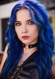 Closeup portrait of beautiful young girl informal model with blue hair royalty free stock image