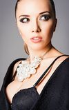 Closeup portrait of beautiful young girl wearing black bra and pearl necklace Royalty Free Stock Images