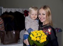 Closeup portrait of beautiful young mother with son. Pretty mommy holding cute baby boy, attractive adult women hugging sweet toddler, cute mom and adorable royalty free stock photography