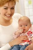 Closeup portrait of beautiful young mum and baby Stock Photography