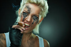 Closeup portrait of a beautiful young punk woman Stock Images