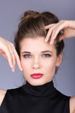 Closeup portrait of beautiful young woman in a black turtleneck Royalty Free Stock Photos