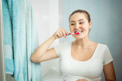 Closeup portrait of beautiful young woman brushing teeth Royalty Free Stock Photos