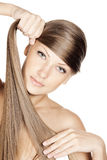 Closeup portrait of a beautiful young woman with elegant long shiny hair Royalty Free Stock Images