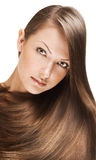 Closeup portrait of a beautiful young woman with elegant long shiny hair , concept hairstyle Royalty Free Stock Images