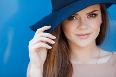Closeup portrait of a beautiful young woman with hat outdoor looking at camera Stock Photo