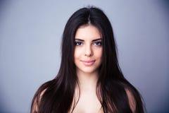 Closeup portrait of a beautiful young woman Stock Photos