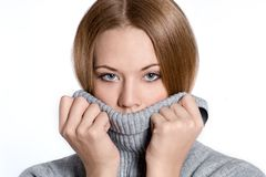 Closeup portrait of a beautiful young woman in a sweater Royalty Free Stock Image