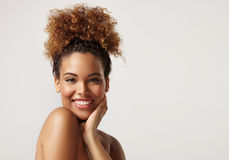 Closeup portrait of a black woman with ideal skin. In studio Royalty Free Stock Image