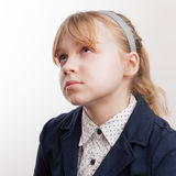 Closeup portrait of blond Caucasian thinking schoolgirl  on whit Stock Images