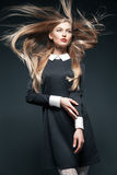 Closeup portrait of blond model posing with hair Royalty Free Stock Photography