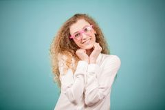 Closeup portrait of blond pretty smiling female looing at the camera Royalty Free Stock Photography
