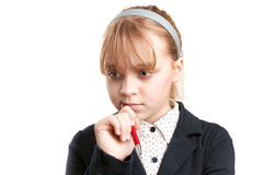 Closeup portrait of blond thinking schoolgirl Stock Photos