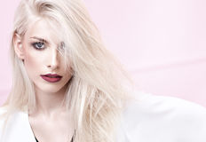 Closeup portrait of a blond young model. Witg deep red lips Royalty Free Stock Images