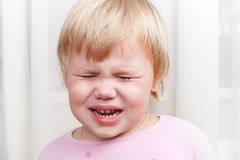 Closeup portrait of blonde crying baby girl Royalty Free Stock Photo