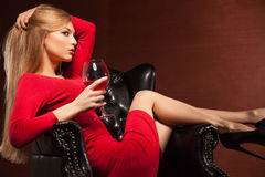 Closeup portrait of  blonde lying in armchair with Royalty Free Stock Photo
