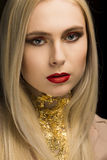 Closeup portrait of blonde model with gold foil on her neck posi Royalty Free Stock Photo