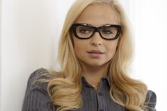 Closeup portrait of blonde woman with glasses Royalty Free Stock Photos