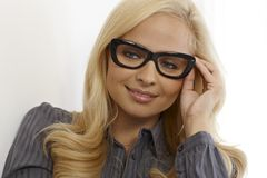 Closeup portrait of blonde woman in glasses Royalty Free Stock Image