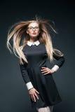 Closeup portrait of blonde woman wearing glasses Stock Image