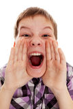 CLOSEUP OF A BOY SCREAMING OUT LOUD. Closeup portrait of a boy  screaming out loud on a white background Royalty Free Stock Image