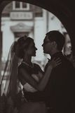 Closeup portrait of bride and groom kissing in ancient tunnel made of bricks Stock Photography