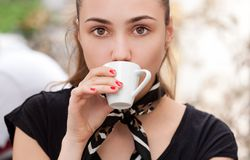 Brunette beauty drinking espresso. Closeup portrait of brunette beauty drinking espresso Royalty Free Stock Images