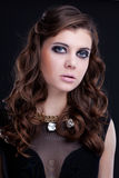 Closeup portrait of brunette woman with smoky eye makeup Stock Photography