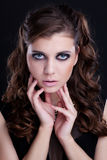 Closeup portrait of brunette woman with smoky eye makeup Royalty Free Stock Photos