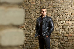 Brutal young sexual man in a leather jacket Royalty Free Stock Photos