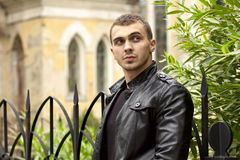Brutal young sexual man in a leather jacket Royalty Free Stock Photo