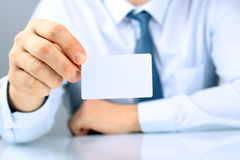 Closeup portrait of  businessman  giving  a  business card Royalty Free Stock Image