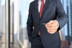 Closeup portrait of  businessman  giving  a  business card Stock Images