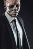 Closeup portrait businessman with makeup skeleton Royalty Free Stock Photo