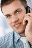 Closeup portrait of businessman on phone. Closeup portrait of young businessman using mobile phone, smiling Stock Photo