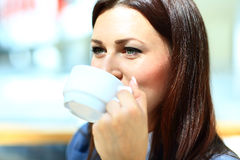 Closeup portrait of businesswoman drinking coffe Royalty Free Stock Photography