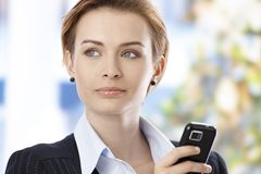 Closeup portrait of businesswoman with mobile stock image
