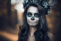 Closeup portrait of Calavera Catrina in black dress. Sugar skull makeup. Dia de los muertos. Day of The Dead. Halloween.  stock photo