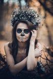 Closeup portrait of Calavera Catrina in black dress. Sugar skull makeup. Dia de los muertos. Day of The Dead. Halloween.  stock photos