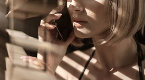 Closeup portrait of a calm woman talking on the phone stock photos