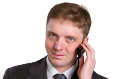 Closeup portrait of casual businessman talking on mobile phone. Isolated on white Royalty Free Stock Photos