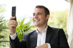 Closeup portrait of casual businessman talking on mobile phone Stock Photo