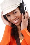 Closeup portrait of casual woman with earphones Royalty Free Stock Image